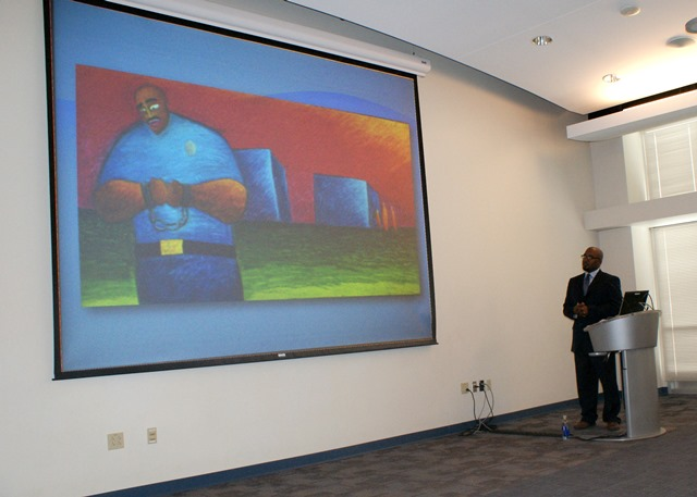 Terrell Carter with an image of one of his paintings